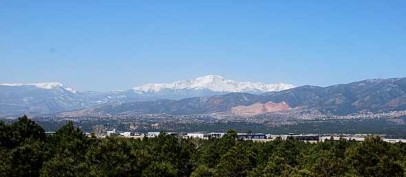 Panoramic photo of the western side of Manitou Springs and Colorado Springs, with Pike's Peak in the center
